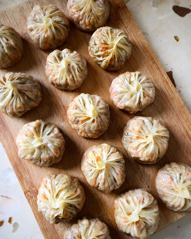 Vegetarian steamed baozi: - prepare the filling: sauté diced scallions, and minc...